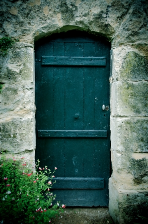 old wooden door in a castle photo