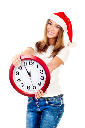 young girl in christmas hat showing clock Stock Photo - 24128516