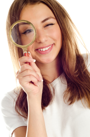 young girl with magnifying glass photo