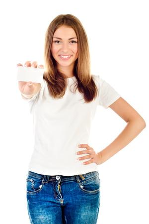 白に分離された空のカードを保持している若い女の子 写真素材
