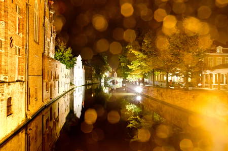 beautiful night cityscape at bruges, belgium photo