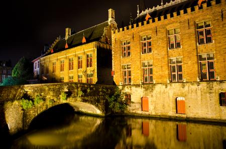 beautiful night cityscape at bruges, belgium photo