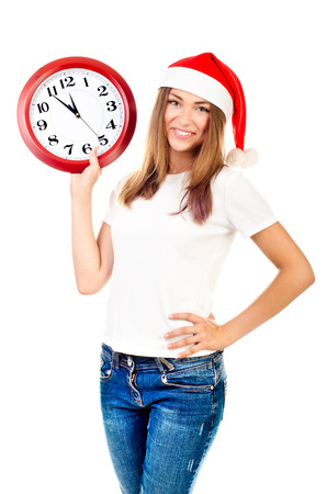 young girl in christmas hat showing clock Stock Photo - 24425462