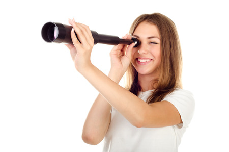 young girl with telescope isolated on a white background photo