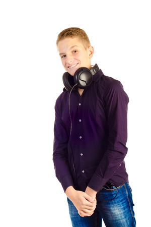 teenage boy with headphones isolated on a white background photo