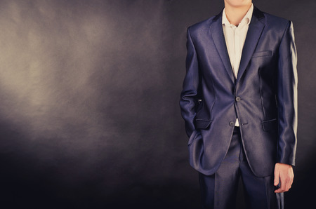 man in suit on a black background photo