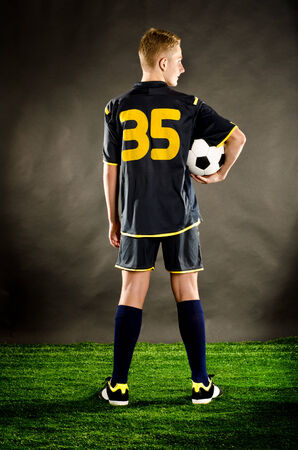 soccer player on a green grass  photo
