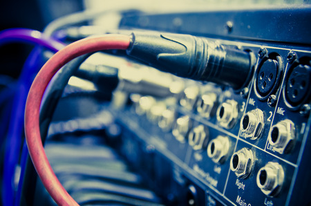 electronic music: audio cable in a studio closeup