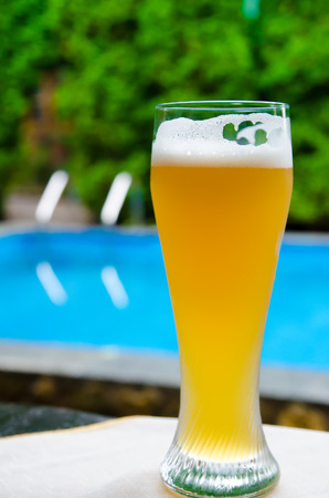 pool water: beer near the pool outdoors Stock Photo