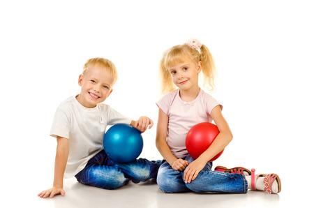 男の子と女の子は、白い背景で隔離 写真素材