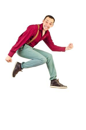 jumping young man isolated on a white background photo