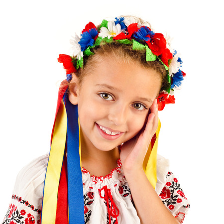 little girl in traditional ukrainian dress isolated on white
