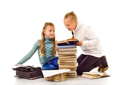 two little girls with a lot of books isolated on a white background photo