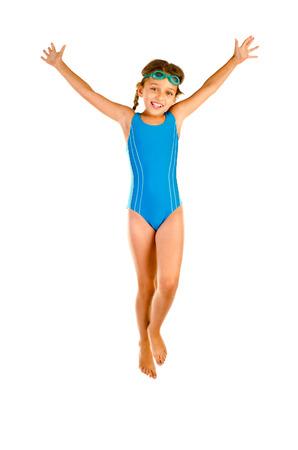 jumping little girl in swimsuit isolated on white Standard-Bild