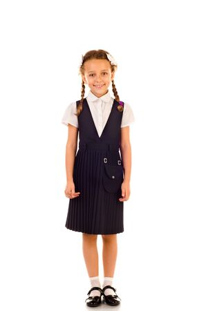 little schoolgirl isolated on a white background Stock Photo