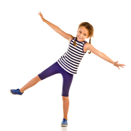 little girl dancing: jumping little girl isolated on a white background Stock Photo