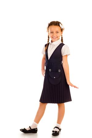 schoolgirl uniform: little schoolgirl isolated on a white background Stock Photo