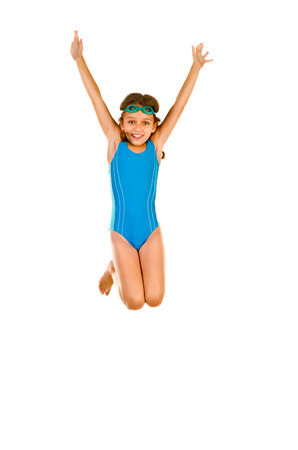 jumping little girl in swimsuit isolated on white Фото со стока