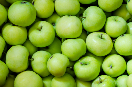 green apples: a lot of green apples as a background