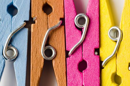 a row of color wooden clothespins