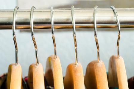 closeup of a lot of wooden hangers