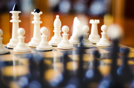 battle plan: chess figures on a board