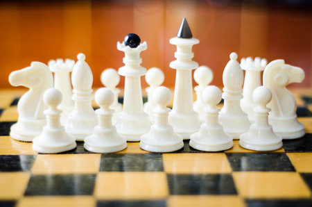 to contemplate: chess figures on a board