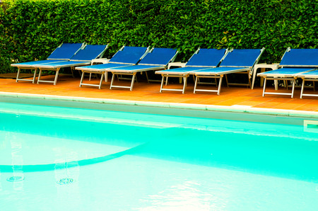 pool with chaise-longues in hotel