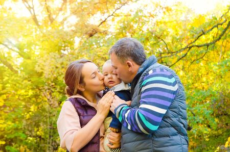 happy family in autumn park Reklamní fotografie
