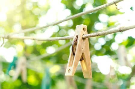 old clothespin on the rope outdoors