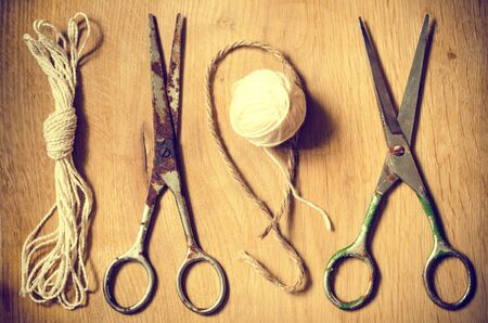 old sewing tools thread and rusty scissors