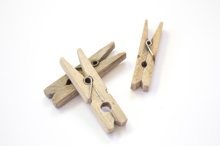 Wooden clothespin on a white background