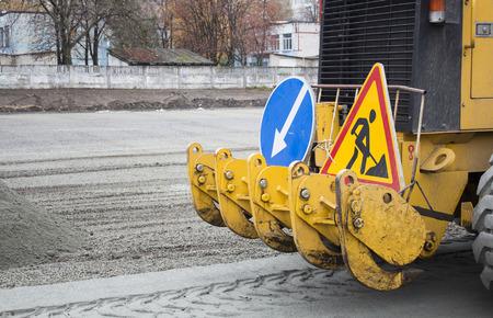 Men at work, asphalt laying. Road-building. Road construction machinery. Road grader