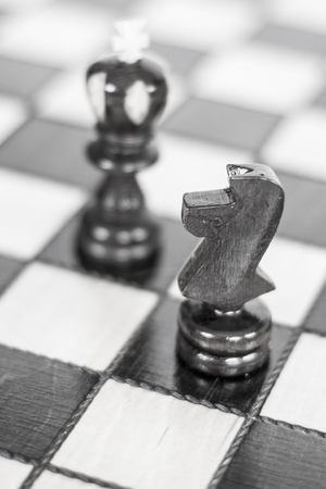 Chess. Chess board. Wooden chess pieces. black and white photo