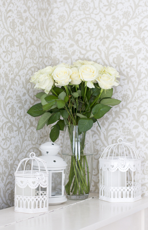 Bouquet of white roses in a vase. White roses and decorative cells Stock Photo