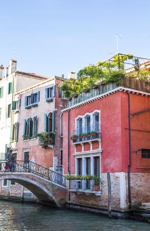 Venetian bridge and houses. Lagoons of Venice Stock Photo