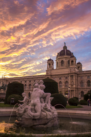 Maria Theresa Square in Vienna. Museum of Natural History in Vienna. Art History Museum in Vienna and the fountain Triton and Naiad. On the Sunset.