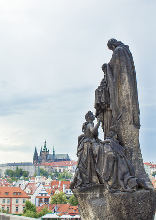 Statues on the Charles Bridge in Prague. Architecture of Prague old town Фото со стока