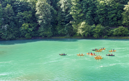 Kayaks on the river Aare. Rafting on the river Aare. Swimmers in Bern Banco de Imagens