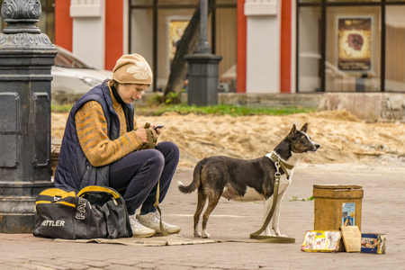 NIZHNY NOVGOROD, RUSSIA - SEPTEMBER 26, 2017: Young woman is raising money for homeless pets shelter to save lives of dogs and cats.