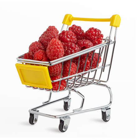 Fresh tasty raspberry in the shopping cart. Creative organic food concept. Bold vivid colors. Isolated on white. Clipping path. Imagens