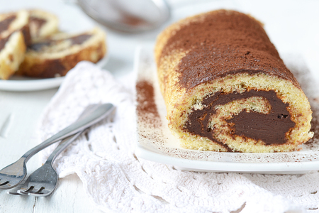 roulade: sponge roulade with chocolate cream Stock Photo