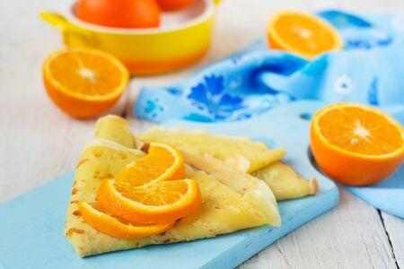 orange crepes, oranges on a white background