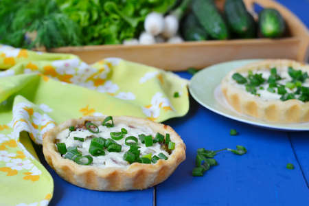 green onions: mini tarts with green onions, bacon and cottage cheese Stock Photo
