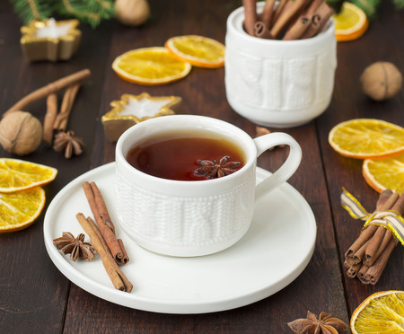 punch spice: tea with spices in a ceramic cup with Christmas decorations