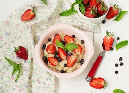 Porridge with berries - strawberries and blueberries