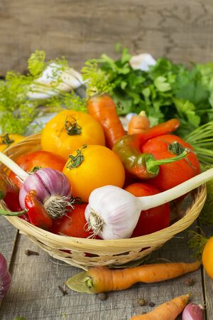 Tomatoes, herbs, garlic - set for home canning. Stock Photo