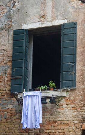 Open Window with a Mans Shirt Hanging out to Dry.  Venice, Italy. photo