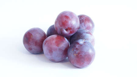 blue plums are isolated on a white background