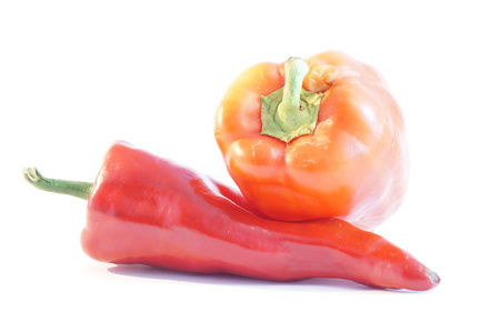 Red and yellow peppers on a white background is insulated. Vegetables on white.